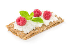 Crispbread with cream cheese and raspberries Royalty Free Stock Photo
