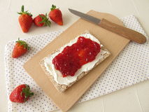 Crispbread with cream cheese and strawberry jam Royalty Free Stock Photography