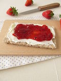 Crispbread with cream cheese and strawberry jam Stock Photos