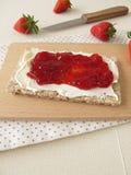 Crispbread with cream cheese and strawberry jam Stock Photos