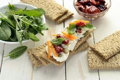 Crispbread with cream cheese, sun-dried tomatoes, herbs Royalty Free Stock Images