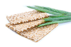 Crispbread with ears and wheat grain Stock Photo