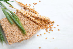 Crispbread with ears and wheat grain Royalty Free Stock Photos