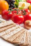 Crispbread with fresh fruits and vegetables Royalty Free Stock Photos