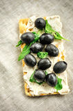 Crispbread with fromage, olives and herbs Stock Image