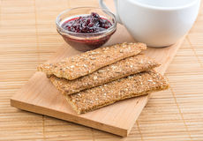 Crispbread and jam. On a wooden stand. Royalty Free Stock Photos
