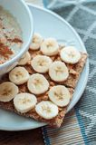 Crispbread with peanut butter and banana. Royalty Free Stock Image