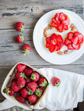 Crispbread with peanut butter and fresh strawberries, rustic, su Stock Image