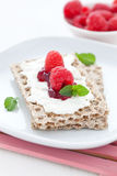 Crispbread with quark and raspberries Royalty Free Stock Images