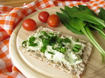 Crispbread with ramsons cream cheese Royalty Free Stock Photo