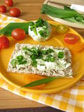 Crispbread with ramsons cream cheese. Crispbread with fresh ramsons cream cheese and tomatoes Stock Image