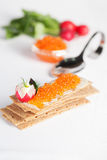 Crispbread and red salmon caviar to supply the ideal figure Royalty Free Stock Image