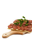 Crispbread with salami. And persley on wooden board, isolated Stock Image