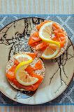 Crispbread with salmon and lemon. On plate Royalty Free Stock Images