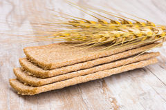 Crispbread and stalks of wheat Stock Image