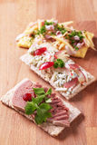 Crispbread with various savory toppings Royalty Free Stock Image