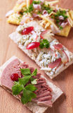 Crispbread with various savory toppings Royalty Free Stock Photo