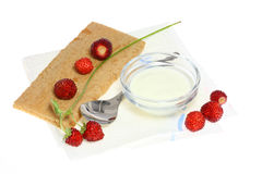 Crispbread and wild strawberries. Royalty Free Stock Image