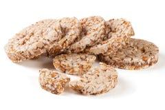Crispbreads зерна изолированные на белой предпосылке Стоковая Фотография