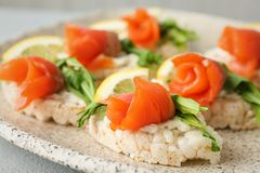 Crispbreads with fresh sliced salmon fillet on plate,. Closeup royalty free stock image
