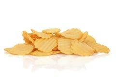 Crisps. Potato crisps isolated over white background with reflection royalty free stock photo