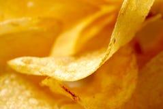 Crisps. Close up take of fried potato crisps stock images