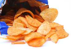 Crisps. Open packet of crisps on white background royalty free stock image