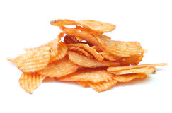 Crisps. Heap of potato crisps isolated on white background royalty free stock image