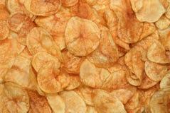 Crisps. Golden potato crisps royalty free stock image
