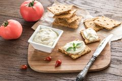 Crisps with cream cheese Royalty Free Stock Image
