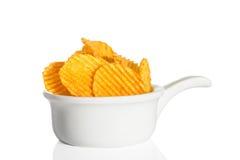 Crisps. Crinkle cut crisps on a white background stock photography