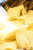 Crisps. Heap of potato crisps on white background royalty free stock image