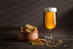 Crisps and pale beer Royalty Free Stock Photography