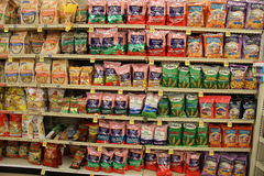 Crisps varieties and Potato chips on a store shelf Royalty Free Stock Photos