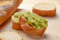 Fresh crunchy avocado cream sandwiches on sliced board royalty free stock images