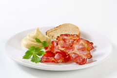 Crispy bacon with bread and mustard Royalty Free Stock Photography