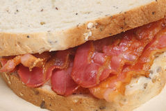 Crispy Bacon Sandwich. With seeded wholewheat bread Royalty Free Stock Photos