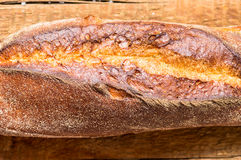 Crispy baguette on a table closeup Royalty Free Stock Photo