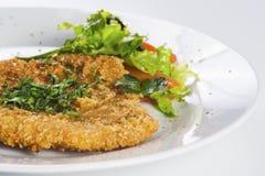 Crispy baked  pork chop served with salad Stock Image