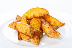Crispy baked potato wedges closeup Royalty Free Stock Photo