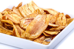 Crispy banana chip on white dish Royalty Free Stock Image