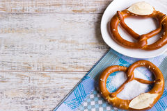 Crispy Bavarian pretzels with salt. Place in the text. National Bavarian pretzels on a wooden table Royalty Free Stock Photography