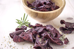 Crispy beetroot chips with rosemary herb Royalty Free Stock Photo
