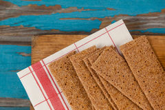 Crispy biscuits with tissue paper on wooden board Royalty Free Stock Photos