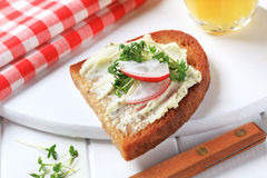 Crispy bread with cheese spread and cress Stock Image