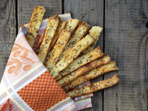 Crispy bread sticks of puff pastry sprinkled with salt and caraway seeds Stock Photography