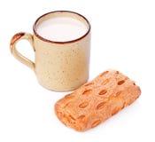Crispy Bun and Mug of Milk Royalty Free Stock Image