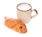 Crispy Bun and Mug of Milk Stock Photography