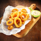 Crispy calamari rings in batter Stock Photos