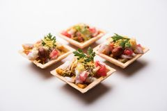 Crispy Canape or canapé is an indian Chat menu. Crispy Canape or canapé is a starter recipe from India - Round or square shaped Puri Filled with Yogurt and royalty free stock photos